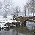 Bridge Over River In A Snowstorm by Fizzy Image