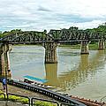 Bridge Over River Kwai In Kanchanaburi-thailand by Ruth Hager