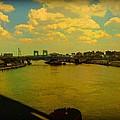 Bridge With Puffy Clouds by Miriam Danar