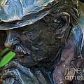 Bronze Man Sitting by Kathryn Strick