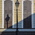 Brown Shutter Doors And Street Lamp - New Orleans by Bill Cannon