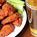 Buffalo Wings With Celery Sticks And Beer by Brandon Bourdages