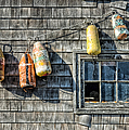 Buoys On A Wall At Peggys Cove by Rob Huntley
