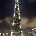Burj Khalifa Tower In Dubai At Night by Nicolae Feraru