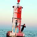 Business Woman On A Buoy by Logan Mock-Bunting