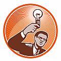 Businessman Holding Lightbulb Woodcut by Aloysius Patrimonio