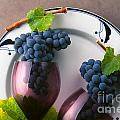 Cabernet Grapes And Wine Glasses by Craig Lovell