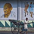 Calcutta - Rickshaw Passing Mahatma Gandhi Rd Metro-station by Urs Schweitzer