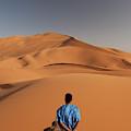 Camels In Sahara Desert. Erg Chebbi by Mauro Ladu