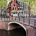 Canal Bridge And Houses In Amsterdam by Artur Bogacki