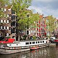 Canal In Amsterdam by Artur Bogacki