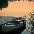 Canoe At A Dock At Sunset by Jill Battaglia