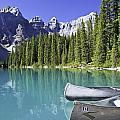Canoes In Moraine Lake And Valley Of by Ken Gillespie
