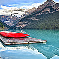 Canoes Of Lake Louise Alberta Canada by George Oze