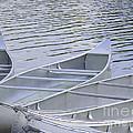 Canoes Waiting by Ann Horn