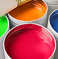 Cans of colored paint by Garry Gay