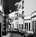 cars parked in a narrow tradtional cobble stone street in Garachico Tenerife Canary Islands Spain vertical by Joe Fox