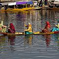 Cartoon - Ladies On A Wooden Boat On The Dal Lake With The Background Of Hoseboats by Ashish Agarwal