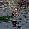 Cartoon - Man Plying A Wooden Boat On The Dal Lake by Ashish Agarwal