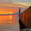 Catching A Navarre Sunset by Mark Olshefski