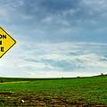Caution Open Range by Eric Benjamin