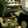 Chairs And Tables In A Garden by Ernst Beadle