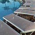 Chairs Around Hotel Pool by Brandon Bourdages