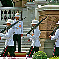Changing Of The Guard Near Reception Hall At Grand Palace Of Thailand In Bangkok by Ruth Hager