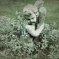 Cherub Statue In The Garden by John Colley