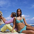 Models Wearing Bikinis Lying On Surfboards By William Connors