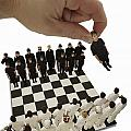 Chess Being Played With Little People by Darren Greenwood