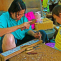 Child Watches As Mom Works In Teak Wood Carving Shop In Kanchanaburi-thailand by Ruth Hager