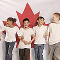 Children In Front Of Canadian Flag by Don Hammond