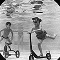Children Playing Under Water by Underwood Archives