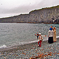 Children Throwing Capelin Back Into The Ocean At Middle Cove-nl by Ruth Hager