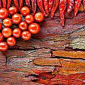 Chilli And Tomato On Rustic Background by Ken Biggs