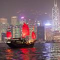 Chinese Junk Sail In Hong Kong Harbor At Night by Matteo Colombo