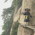 Chinese Monk Walking Along On Mountain Pathway by King Wu