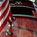 Chris Craft With Flag And Steering Wheel by Michelle Calkins