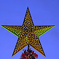 Christmas Star During Dusk Time by George Atsametakis