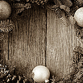 Christmas Wreath With Ornaments And Pine Cones On Rustic Wood Ba by Brandon Bourdages