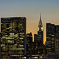 Chrysler And Un Buildings Sunset by Susan Candelario
