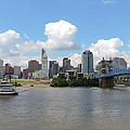 Cincinnati Skyline With A Boat by Cityscape Photography