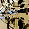 Circular Doors On Laundromat Washing Machines by Amy Cicconi
