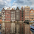 City Of Amsterdam At Sunset In Netherlands by Artur Bogacki
