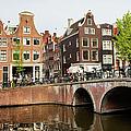 City Of Amsterdam In Holland by Artur Bogacki