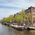City Of Amsterdam In The Netherlands by Artur Bogacki
