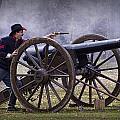 Civil War Reenactor Firing A Revolver by Randall Nyhof