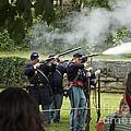 Civil War Soldier Reenactors Fire Muskets At Harpers Ferry West Virginia by William Kuta