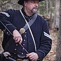 Civil War Union Soldier Reenactor Loading Musket by Randall Nyhof